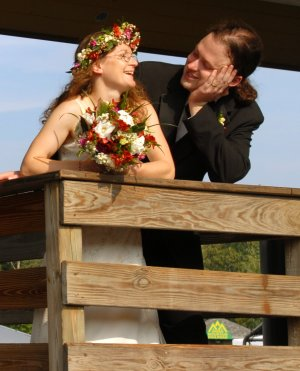Bride and groom, with flowers.